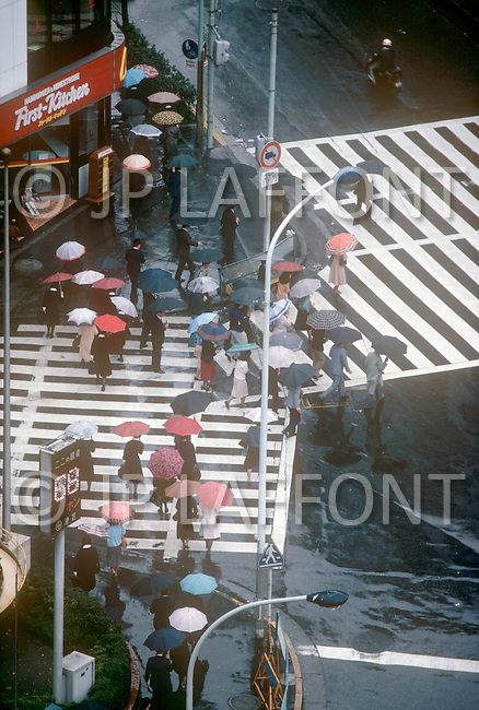 October, 1980. Tokyo, Japan. Typical traffic and pedestrian congestion in Ginza district of Tokyo.