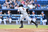 Hickory Crawdads left fielder Eric Jenkins (5) runs to first base during a game against the Asheville Tourists at McCormick Field on July 13, 2017 in Asheville, North Carolina. The Tourists defeated the Crawdads 9-4. (Tony Farlow/Four Seam Images)