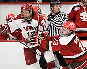 Rence Coassin (Harvard - 17), Jacob Drewiske (St. Lawrence - 13) - The Harvard University Crimson defeated the St. Lawrence University Saints 4-3 on senior night Saturday, February 26, 2011, at Bright Hockey Center in Cambridge, Massachusetts.