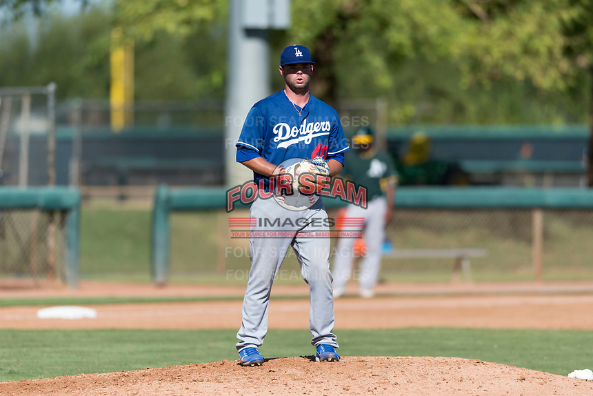Los Angeles Dodgers relief pitcher Bryan Warzek (40) gets ready to deliver a pitch during an Instructional League game against the Oakland Athletics at Camelback Ranch on September 27, 2018 in Glendale, Arizona. (Zachary Lucy/Four Seam Images)
