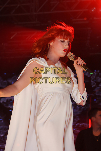 FLORENCE WELCH of FLORENCE AND THE MACHINE.Performs live during Radio One's Big Weekend, Bangor, North Wales, .UK, May 22nd 2010..1 1's music live on stage concert gig half length white cream long dress microphone singing .CAP/MAR.© Martin Harris/Capital Pictures.