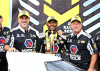Jul 10, 2016; Joliet, IL, USA; NHRA top fuel driver Antron Brown (center) celebrates with co crew chiefs Brian Corradi (left) and Mark Oswald after winning the Route 66 Nationals at Route 66 Raceway. Mandatory Credit: Mark J. Rebilas-USA TODAY Sports