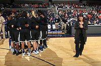 Duke teammates huddle near Duke head coach Joanne P. McCallie during an NCAA college basketball game in Charlottesville, Va. Duke defeated Virginia 62-41...