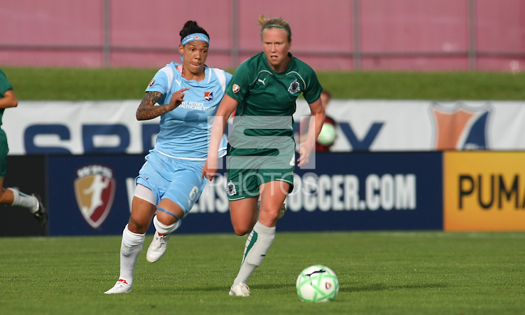 Sara Larsson of Athletica turns the ball away from Sky Blue's Natasha Kai.  St. Louis Athletica defeated Sky Blue FC 2-1 at Yurcak Field at Rutgers University in Piscataway, NJ on June 28, 2009.
