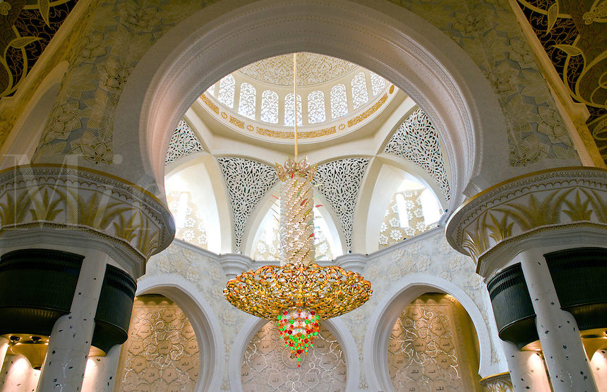 Large colorful chandelier in the beautiful white Sheikh Zayed Grand Mosque in Abu Dhabi in the UAE the worlds 8th largest Muslim mosque in the world