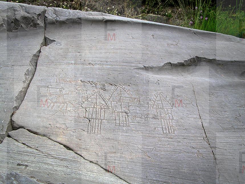 Parco Nazionale delle incisioni rupestri di Campo di Ponte in Valcamoonica, provincia di Brescia. Scene del villaggio incise sulla roccia n. 35