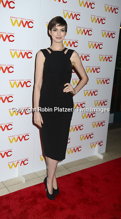 Anne Hathaway in Victoria Beckham black dress attends the Women's Media Center 2012 Women's Media Awards on November 13, 2012 at Guastavinos in New York City.