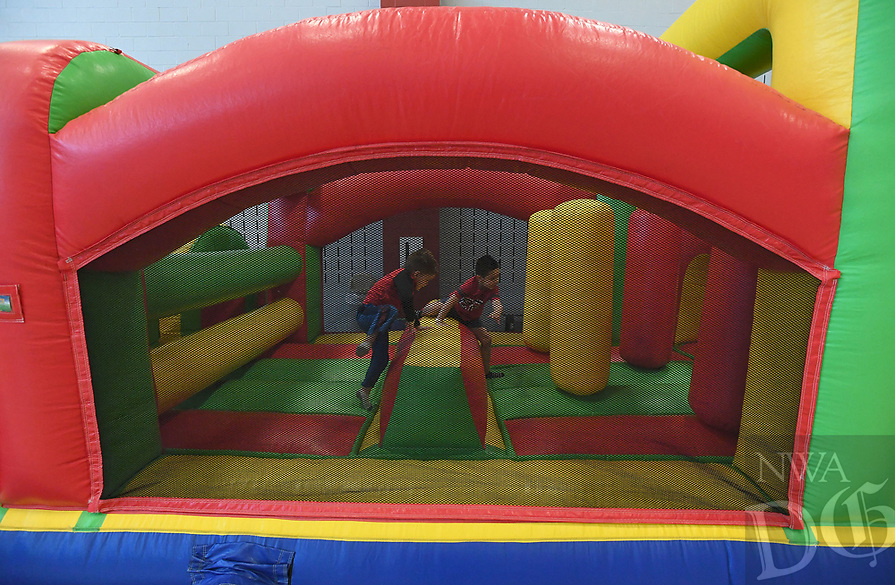NWA Democrat-Gazette/J.T. WAMPLER Children race through an inflatable obstacle course Monday March 18, 2019 at the Jones Center in Springdale. The center is open all week for spring break with extended hours. The pool, gym and rink will be open all week with a special activity scheduled for each day through week. For information on activities at the Jones Center visit www.thejonescenter.net