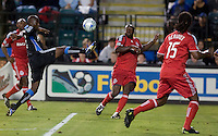 Cornell Glen kicks the ball between Toronto FC players. Toronto FC defeated San Jose Earthquakes 3-1 at Buckshaw Stadium in Santa Clara, California on July 11, 2009.