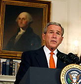 United States President George W. Bush announces he will widen economic sanctions on Myanmar's military rulers, piling on pressure for a transition to democracy after a bloody crackdown on anti-junta protests, in the Diplomatic Room of the White House in Washington, DC on October 19, 2007. The move comes only days after the European Union increased its sanctions against the regime. <br /> Credit: Aude Guerrucci / Pool via CNP