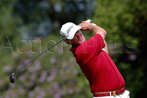 30 May, 2004: Swedish golfer JOAKIM HAEGGMAN (SWE) looks into the distance after playing a wood during the final round. Haeggman finished in third place on 16 under par. Volvo PGA Championship at Wentworth Photo: Glyn Kirk/Action Plus...golf  player 040530