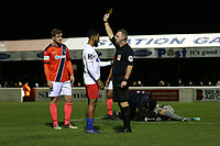 Reece Grant of Dagenham receives a yellow card after a foul on Chris Dunn of Maidenhead during Dagenham & Redbridge vs Maidenhead United, Vanarama National League Football at the Chigwell Construction Stadium on 7th December 2019