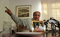 FILE PHOTO: Bipin C. Shah speaks to the media during a news conference at his home in Rosemont, PA., Dec. 18, 1997, to announce a $2 Million dollar reward he is offering for information leading to the return of Genevieve (Vivi) Marie Shah, 6, and Sarah Lynn Shah, 8. Both are pictured in a photo on the desk. He announced Tuesday, April 13, 1999, that he had found his daughters in Switzerland, spending $3 million in the process. The FBI has issued a warrnt for the arrest of his ex-wife, Ellen Dever, who is accused of fleeing with the children in Dec. 1997. (photo by William Thomas Cain) PHILADELPHIA INQUIRER OUT