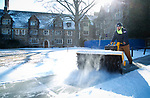 Baxter Remington, a West grounds equipment operator, clears sidewalks around the Clocktower Quad Thursday morning. Remington said he started work at 5am and that he and other crews will be busy spreading Ice Melt to help keep sidewalks safe.