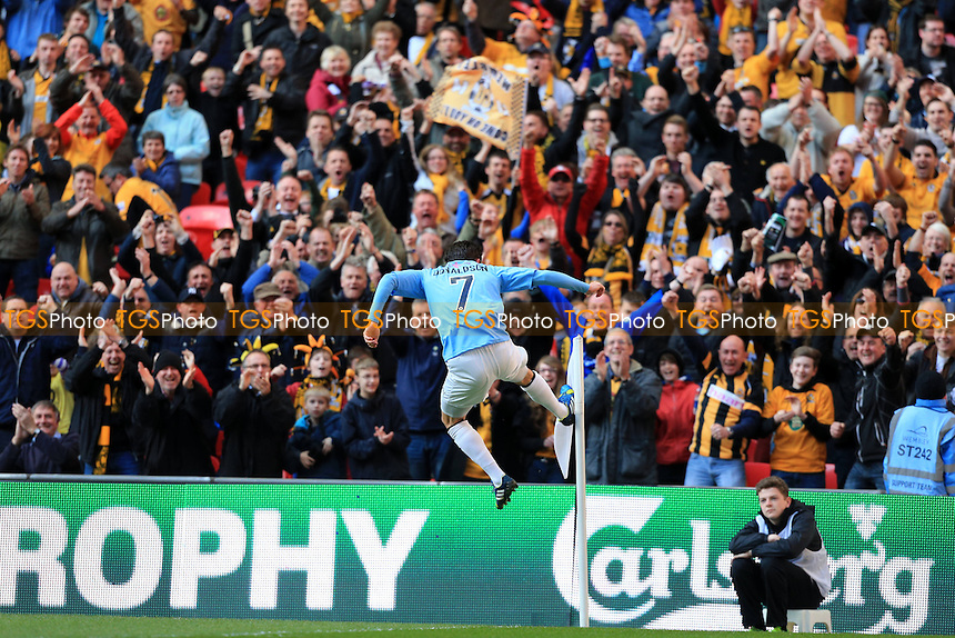 Ryan Donaldson of Cambridge United celebrates in front of the Cambridge United fans - Cambridge United vs Gosport Borough - FA Challenge Trophy Final at Wembley Stadium, London - 23/03/14 - MANDATORY CREDIT: Simon Roe/TGSPHOTO - Self billing applies where appropriate - 0845 094 6026 - contact@tgsphoto.co.uk - NO UNPAID USE
