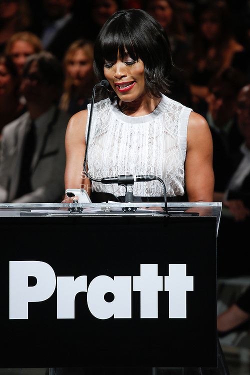 "Actress Angela Bassett honors designers Byron Lars, for his 2014 Pratt Fashion Visionary Award, at the 115th Annual Pratt Institute 2014 ""Under Construction"" collection Student Runway Show;  at Center548 in NYC, on May 1, 2014."