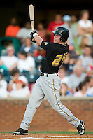 West Virginia left fielder Stephen Chapman (24) follows through on his swing versus Lexington at Applebee's Park in Lexington, KY, Thursday, June 7, 2007.
