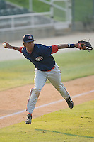 Third baseman Michael Almanzar (23) of the Greenville Drive makes an off-balance throw to first base at Fieldcrest Cannon Stadium in Kannapolis, NC, Sunday August 10, 2008. (Photo by Brian Westerholt / Four Seam Images)