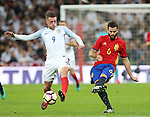 England's Jamie Vardy tussles with Spain's Nacho during the friendly match at Wembley Stadium, London. Picture date November 15th, 2016 Pic David Klein/Sportimage