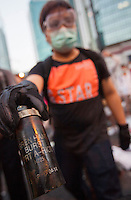 A pro-democracy protester holds up a spent tear gas grenade by the Hong Kong government headquarters in Hong Kong's downtown district, on the first day of the mass civil disobedience campaign Occupy Central, Hong Kong, China, 28 September 2014.