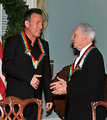 Washington, DC - December 5, 2009 -- 2009 Kennedy Center honorees Bruce Springsteen, left, and Mel Brooks, right, engage in conversation as they prepare to pose with the other honorees for the formal group photo following the Artist's Dinner at the United States Department of State in Washington, D.C. on Saturday, December 5, 2009.  .Credit: Ron Sachs - Pool via CNP