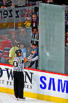 18 December 2008: NHL Referee Dan Marouelli inspects a shattered glass panel in the third period during a game between the Philadelphia Flyers and the Montreal Canadiens at the Bell Centre in Montreal, Quebec, Canada. The Canadiens, trying to avoid a four-game slide, defeated the Philadelphia Flyers 5-2, thus ending Philadelphia's 5-game winning streak. ***** Editorial Sales Only ***** Mandatory Photo Credit: Ed Wolfstein Photo