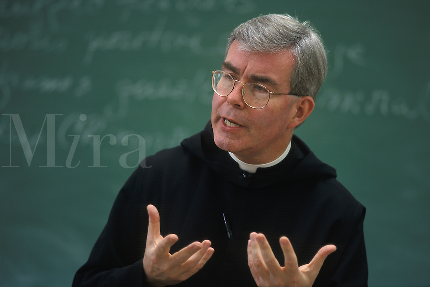 College professor, a monk, teaching class in English / Journalism.