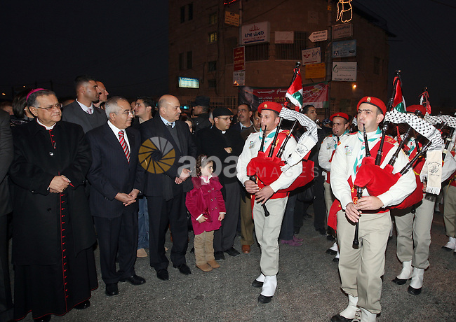 Palestinian Prime Minister, Salam Fayyad participates in the Christmas tree lighting in Beit Sahour in West Bank City of Bethlehem on Dec 19,2010. Photo by Mustafa Abu Dayeh