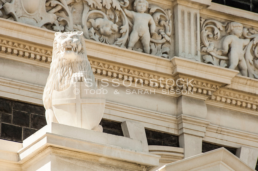 Architectural detail - stone lion statue - at the Dunedin Railway Station, Dunedin CIty, New Zealand - stock photo, canvas, fine art print
