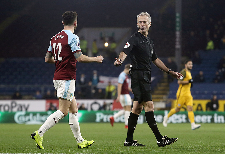 Burnley's Robbie Brady remonstrates with Referee Martin Atkinson<br /> <br /> Photographer Rich Linley/CameraSport<br /> <br /> The Premier League - Burnley v Brighton and Hove Albion - Saturday 8th December 2018 - Turf Moor - Burnley<br /> <br /> World Copyright © 2018 CameraSport. All rights reserved. 43 Linden Ave. Countesthorpe. Leicester. England. LE8 5PG - Tel: +44 (0) 116 277 4147 - admin@camerasport.com - www.camerasport.com