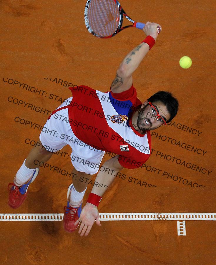 Tennis Tenis<br /> Davis Cup semifinal polufinale<br /> Serbia v Canada<br /> Janko Tipsarevic v Milos Raonic<br /> Janko Tipsarevic serves the ball<br /> Beograd, 13.09.2013.<br /> foto: Srdjan Stevanovic/Starsportphoto &copy;