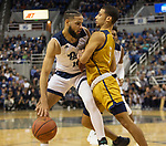 Nevada forward Caleb Martin (10) drive into California Baptist guard Jeremy Smith (5) in the first half of an NCAA college basketball game in Reno, Nev., Monday, Nov. 19, 2018. (AP Photo/Tom R. Smedes)