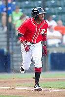Francisco Peguero #49 of the Richmond Flying Squirrels hustles down the first base line against the Harrisburg Senators in game one of a double-header at The Diamond on July 22, 2011 in Richmond, Virginia.  The Squirrels defeated the Senators 3-1.   (Brian Westerholt / Four Seam Images)