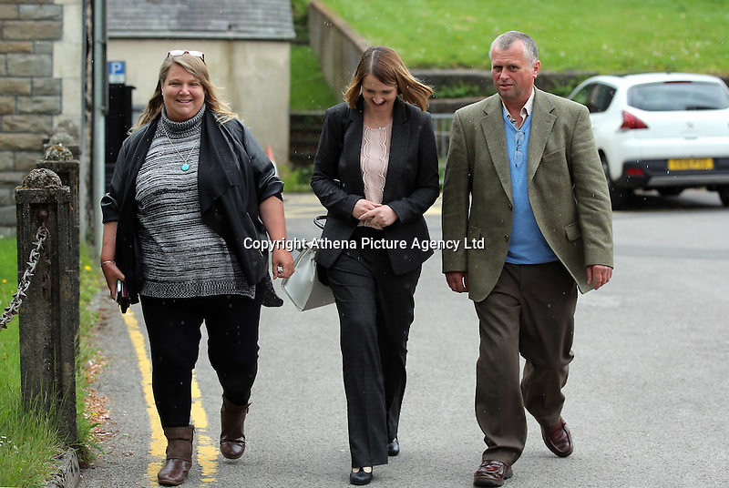 """COPY BY TOM BEDFORD<br />Pictured: Christopher Sabine (R), the son of John Sabine from a previous marriage, outside the Aberdare Coroner's Court after the verdict Thursday 19 May 2016<br />Re: A man found wrapped in plastic in his Rhondda Cynon Taff garden was unlawfully killed, a coroner has concluded.<br />The body of John Henry Sabine was found at the rear of flats at Trem-y-Cwm, Beddau, on 24 November. The cause of death was blunt force head trauma.<br />Mr Sabine's wife Leigh Ann, who died last October, is the main suspect.<br />His inquest in Aberdare was told she admitted killing her husband with a stone frog in a phone call to a friend.<br />South Wales Central Coroner Andrew Barkley said it was """"beyond doubt in my mind that foul play was the cause of his death"""".<br />He said the cause was blunt force injury to the head, with the evidence about the stone frog fitting with this.<br />The coroner said there was no recorded history of domestic violence or that Mrs Sabine acted in self defence and he was satisfied her husband was unlawfully killed."""