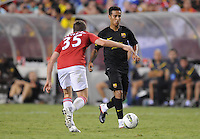 FC Barcelona midfielder Thiago Alcantara (4) goes against Manchester United midfielder Tom Cleverly (35) Manchester United defeated Barcelona FC 2-1 at FedEx Field in Landover, MD Saturday July 30, 2011.