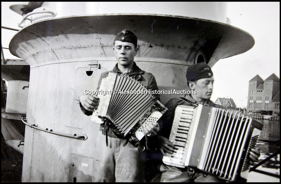 BNPS.co.uk (01202 558833)<br /> Pic: AlexanderHistoricalAuctions/BNPS<br /> <br /> Two men playing the accordion on the U-Boat.<br /> <br /> Fascinating images which provide a snapshot of life on a German U-Boat have been unearthed.<br /> <br /> Interestingly, the photographs give us an insight into joyous occasions on the U-976 destroyer including alcohol fuelled parties and gatherings in the mess hall.<br /> <br /> The photo album which was collated by First Officer Lieutenant Wilhelm Hinrichs has now emerged for auction and is tipped to sell for £1,200.<br /> <br /> The U-976 was sunk on March 25, 1944, just a few months before the Normandy landings, near St Nazaire in France by gunfire from two British Mosquito fighter-bombers.