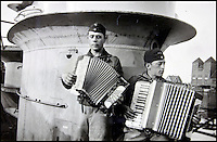 BNPS.co.uk (01202 558833)<br /> Pic: AlexanderHistoricalAuctions/BNPS<br /> <br /> Two men playing the accordion on the U-Boat.<br /> <br /> Fascinating images which provide a snapshot of life on a German U-Boat have been unearthed.<br /> <br /> Interestingly, the photographs give us an insight into joyous occasions on the U-976 destroyer including alcohol fuelled parties and gatherings in the mess hall.<br /> <br /> The photo album which was collated by First Officer Lieutenant Wilhelm Hinrichs has now emerged for auction and is tipped to sell for &pound;1,200.<br /> <br /> The U-976 was sunk on March 25, 1944, just a few months before the Normandy landings, near St Nazaire in France by gunfire from two British Mosquito fighter-bombers.