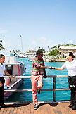 BERMUDA. St. George. Chef Marcus Samuelsson on a bridge in St. George with two local waitresses running over to shake his hand and get a photo.