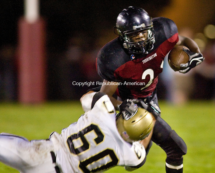 TORRINGTON, CT - 10 OCTOBER 2008 -101008JT10--<br /> Torrington's Dwayne White gets tackled by Woodland's Mike Uszakiewicz during Friday's game at Torrington.<br /> Josalee Thrift / Republican-American
