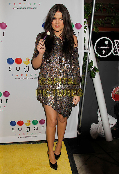 KHLOE KARDASHIAN.Mel B's Sugar Factory Couture Lollipop Series Launch Party at Guys and Dolls Lounge, West Hollywood, California, USA..January 19th, 2010.full length bronze gold beads beaded dress black shoes sweet candy sequins sequined off the shoulder .CAP/ADM/MJ.©Michael Jade/AdMedia/Capital Pictures.