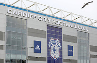 A general view of the front window of the Cardiff City Stadium which is covered by the Cardiff City emblem with the Adidas, Ricoh and Visit Malaysia logos next to it prior to kick off of the Sky Bet Championship match between Cardiff City and Birmingham City at The Cardiff City Stadium, Cardiff, Wales, UK. 11 March 2017