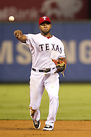 Texas Rangers shortstop Elvis Andrus #1 throws to first during the Major League Baseball game against the Baltimore Orioles on August 21st, 2012 at the Rangers Ballpark in Arlington, Texas. The Orioles defeated the Rangers 5-3. (Andrew Woolley/Four Seam Images).