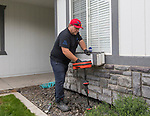 Absolute Drain owner Mickey Castonguay uses a ridgid locator out front of a house in Sparks, Nevada on Monday, August 14, 2017.