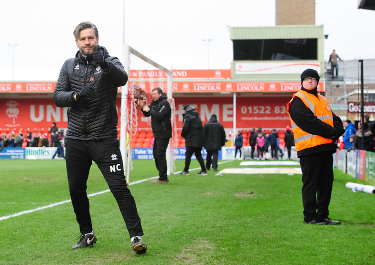 Lincoln City's assistant manager Nicky Cowley acknowledges the fans at the end of the game<br /> <br /> Photographer Chris Vaughan/CameraSport<br /> <br /> The EFL Sky Bet League Two - Lincoln City v Grimsby Town - Saturday 19 January 2019 - Sincil Bank - Lincoln<br /> <br /> World Copyright © 2019 CameraSport. All rights reserved. 43 Linden Ave. Countesthorpe. Leicester. England. LE8 5PG - Tel: +44 (0) 116 277 4147 - admin@camerasport.com - www.camerasport.com