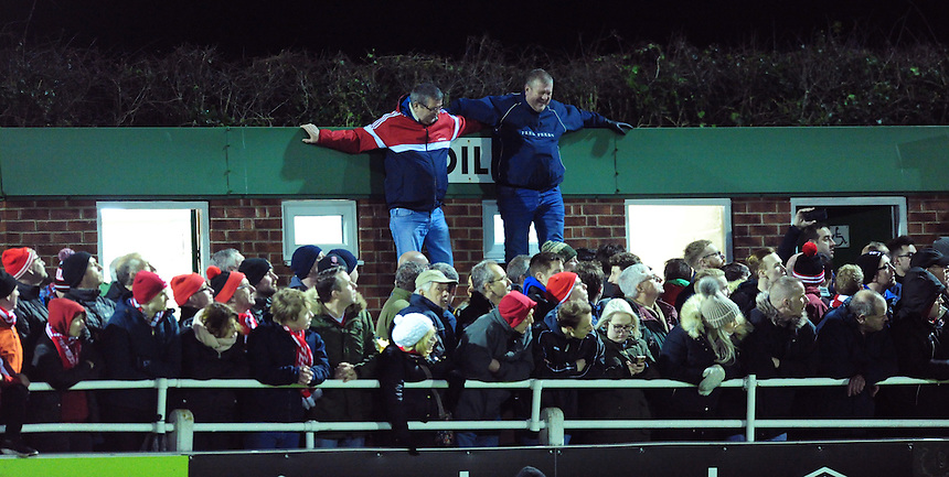 Spectators do their best to ensure they get a good view of the game<br /> <br /> Photographer Chris Vaughan/CameraSport<br /> <br /> Vanarama National League - North Ferriby United v Lincoln City - Tuesday 21st February 2017 - Grange Lane - North Ferriby<br /> <br /> World Copyright &copy; 2017 CameraSport. All rights reserved. 43 Linden Ave. Countesthorpe. Leicester. England. LE8 5PG - Tel: +44 (0) 116 277 4147 - admin@camerasport.com - www.camerasport.com