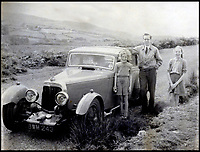 BNPS.co.uk (01202 558833)<br /> Pic:  H&HClassics/BNPS<br /> <br /> Philip Kenyon bought the car in 1953, seen here with his daughters Joan and Ann.<br /> <br /> A clapped-out classic car that has spent almost 50 years languishing in a garage is tipped to sell for £55,000.<br /> <br /> The rare and original Aston Martin Mk II saloon car was built in 1936 and was one of just 24 made by the famous British marque.<br /> <br /> The model now for sale was bought in 1951 for a mere £300 by the late Philip Kenyon. <br /> <br /> The war hero electrical engineer happily drove it throughout the 1950s and '60s before its handbrake broke and put it in a garage.