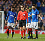 29.11.2018 Rangers v Villarreal: Puzzled referee looks towards linesman and realises that he has already booked Daniel Candeias