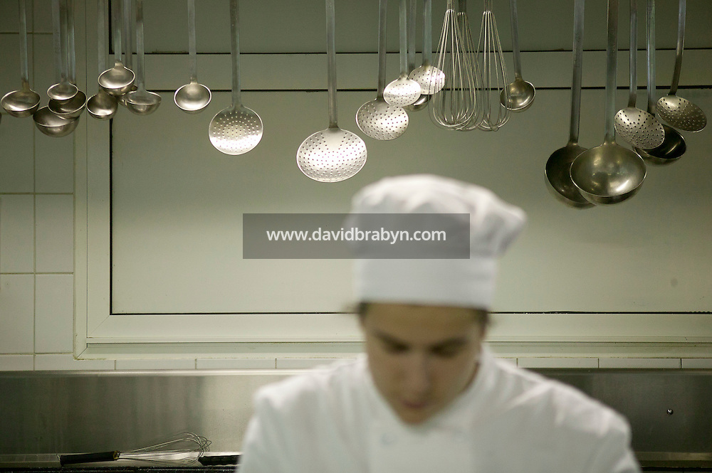 A student cooks during a class at the Ecole Superieure de Cuisine Francaise Gregoire Ferrandi cooking school in Paris, France, 18 December 2007.