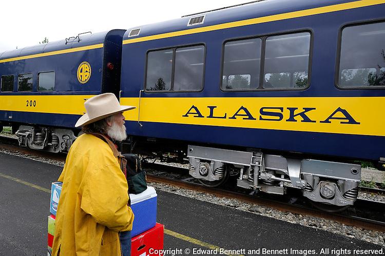 Jim James waits to board the Hurricane Turn train at the station in Talkeetna, Alaska.The Alaska Railroad's Hurricane Turn is one of America's last true whistlestop trains.