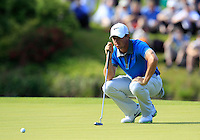 Rory McIlroy (NIR) lines up his putt on the 18th green during Friday's Round 2 of the 2014 Irish Open held at Fota Island Resort, Cork, Ireland. 20th June 2014.<br /> Picture: Eoin Clarke www.golffile.ie